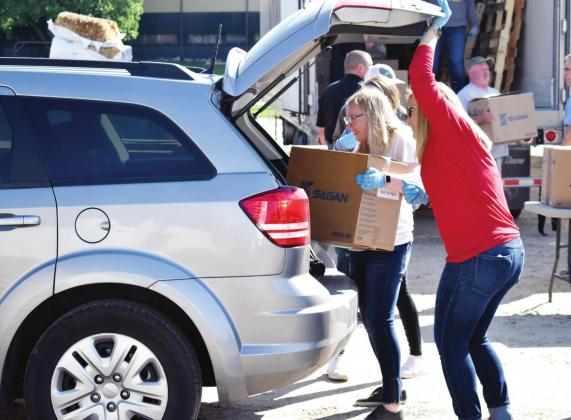 Groceries for 2,400 families given away, April 11: Cars lined up along Houston Street, State Highway 19 and Main Street, as Bob Evans Farm held a free grocery drive-thru for families in need Friday at the Hopkins County Regional Civic Center. File photo by Todd Kleiboer