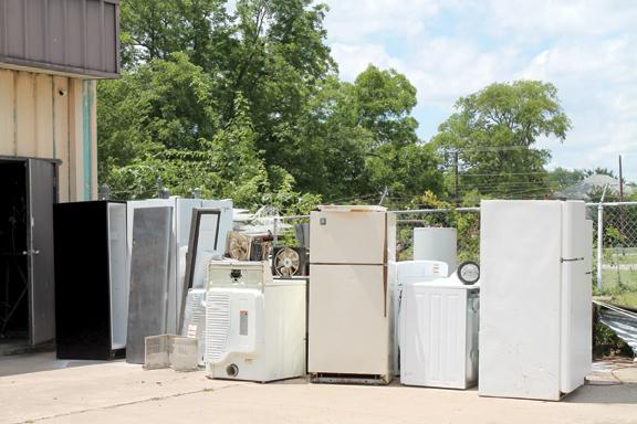 Refrigerators, washing machines and air conditioners located in front of JR Services on Jackson Street. Staff photo by Taylor Nye