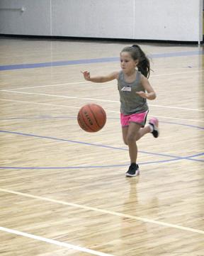 Maebry Mitchell practices her dribbling skills during day one of the Ladycat Basketball Camp.