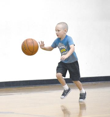 Rydell Hurley practices his dribbling skills at the annual Como-Pickton basketball camps. Staff photos by Quinten Boyd