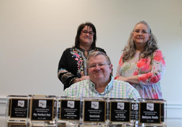 EDC members from left- Glenda Bassham, Roger Feagley and Mitzi Y'Barbo with glass paperweights that each represent a business relocated to Sulphur Springs