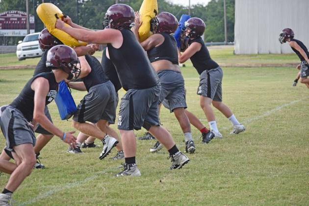 Cumby football players go through line drills during an Aug. 5 workout at the high school practice field. The Trojans will scrimmage Thursday at Quinlan Boles. They open the regular season Aug. 30 at home against Quitman. Staff photo by Quinten Boyd