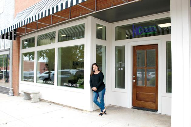 Chamber President Lezley Brown proudly shows off the new location for the Hopkins County Chamber of Commerce. The Chamber moved into its new permanent location on Celebration Plaza in early August. Staff photo by Tammy Vinson