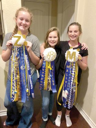 Sporting mums for this year's Sulphur Springs Homecoming are Zoe Reed, seventh grade; Kyleigh Tadlock sixth grade; and Mally Keaton, sixth grade. Courtesy