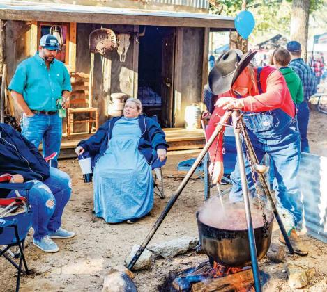 The Rock Creek Health & Rehab stew cooking team dressed in period costumes and decorated their stew site in Buford Park at the 2018 Hopkins County Stew Contest. Archive