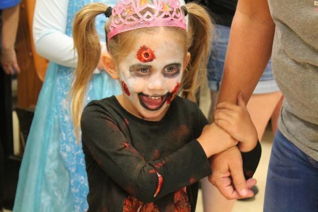 Laikyn Kerby, dressed as a zombie princess, is thrilled to learn she is the winner of the scariest costume in the pre-kindergarten division at Miller Grove's Halloween carnival on Thursday, Oct. 25 Staff photo by Taylor Nye