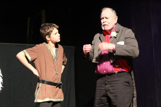 Brave hero Atreyu, played by Nathan Bilyieu, speaks with Professor Engywook, played by John D'Avignon, to figure out how to find the Southern Oracle to save the life of the Childlike Empress, ruler of Fantastica. Staff photos by Tammy Vinson