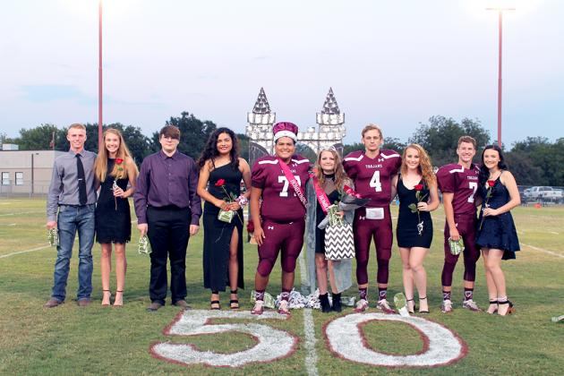 Cumby homecoming king and queen, Elijah Pachcheka and Abby Baxter (center) stand at the 50-yard line during their crowning.