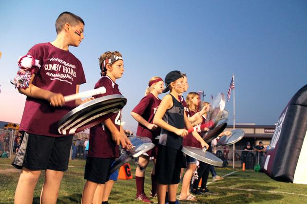 "Cumby's ""Trojan Shields of Pride"" spirit section makes their inaugural appearance at Friday's homecoming game to welcome the football team onto the field."