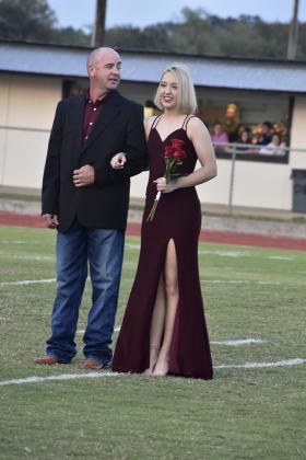 Homecoming Queen candidate Sydnee Neal and her father Shawn await the announcement of the queen. Staff photos by Todd Kleiboer