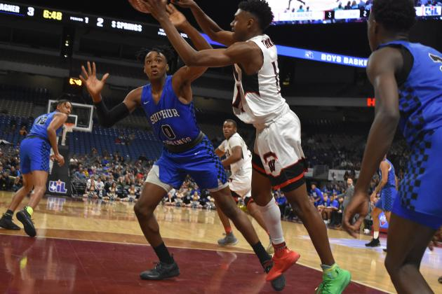 "Sadaidriene ""Day Day"" Hall (left) 6-6 power forward from Sulphur Springs is shown in state tournament action against San Antonio Wagner. The Wildcats open the basketball season ranked No. 5 in Class 5A while Wagner is No. 2. File photo"