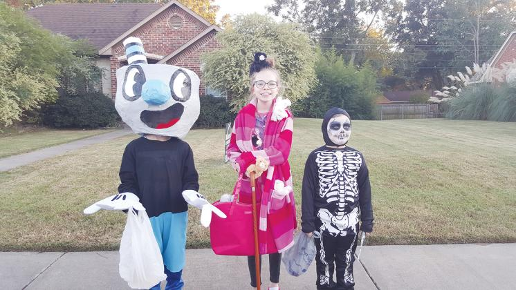 From left, Hayden Bowers, 9, as Mugman; Addison Bowers, 13, as a crazy cat lady; and Oliver Price, 5, as a Skull Ranger from Fortnite. Courtesy/Crystal Bowers