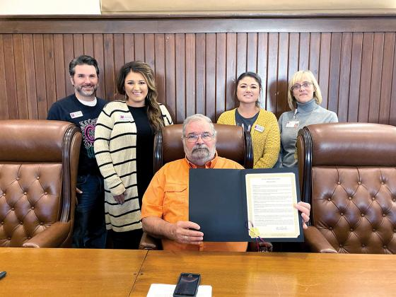 Cypress Basin Hospice staff pictured with City of Sulphur Springs Mayor Norman Sanders presenting the 2019 National Hospice Month Proclamation. Courtesy/ Cypress Basin Hospice