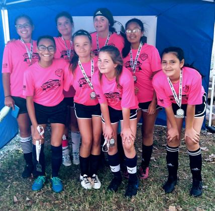 The U16 Pink Team, coached by Michael Noe, won second place in their division.