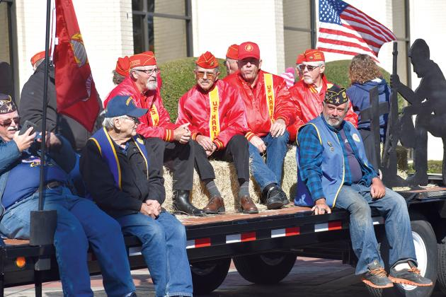 Members of the Hopkins County Marine Corps League Detachment 1357 rode through downtown Sulphur Springs in the Veterans Day Parade held Saturday. For more photos of the parade, see page 10A or go online t ssnewstelegram.com. In the red jackets are (from left) Larry Vickers, Chuck Jones, Jerry Wilhite and Garry Hall. Staff photo by Jillian Smith