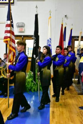 The Sulphur Springs High School band members carry the U.S. flag ahead of the flags representing the different branches of the U.S. military at the school's patriotic program held in their gym on Veterans Day. Courtesy/SSISD, Cindy Welch