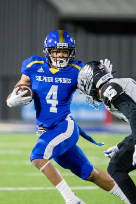 Wildcat wide receiver Bryant Sanchez holds off a North Forney defender. Courtesy/Cathy Bryan