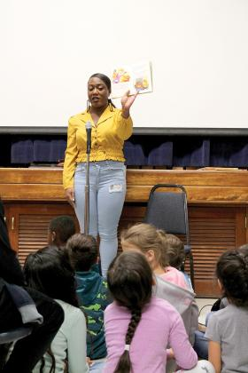 Erica Antoinette Bryant reads to kindergartners at Bowie Primary Friday. Staff photo by Taylor Nye