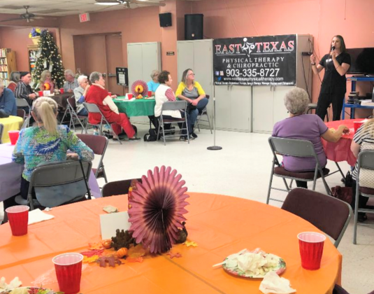 Leslie Ann Northcutt (standing), doctor of physical therapy with East Texas Physical Therapy, 1501 Holiday Drive in Sulphur Springs, gave a program on Therapy and Fall Prevention on Monday, Nov. 25 at the Sulphur Springs Senior Citizens Center, 150 Martin Luther King Jr. Drive. The seniors were treated to catered meal from Roma's Italian Restaurant before the program. Courtesy/Karon Weatherman