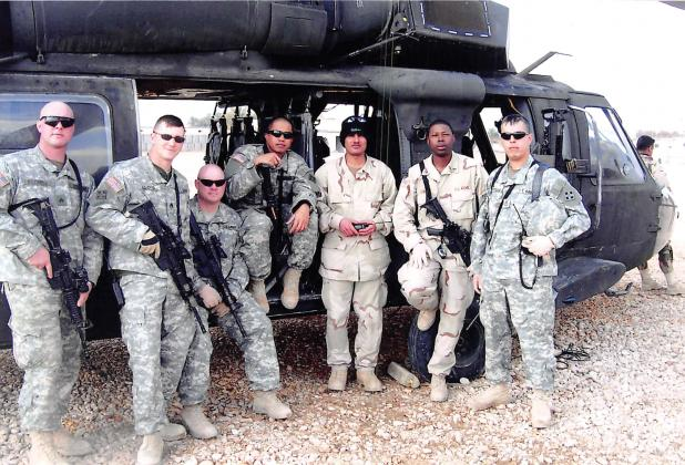 Chad Lloyd (second from left) poses with his unit in Afghanistan in this March 2006 photo. Courtesy/Jimmy and Dena Lloyd