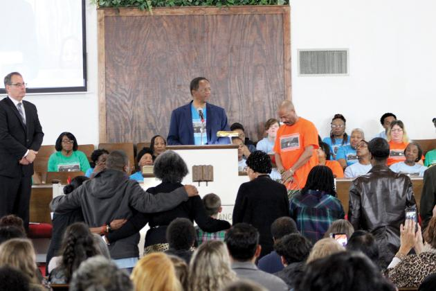Sulphur Springs city council member Rev. Harold Nash (center) read a proclamation during the Martin Luther King Jr. celebration and social justice awards presentation for the family of Jimmie Lurleene Harrison, former Sulphur Springs educator who passed away Dec. 16, 2019, held at Morning Chapel Missionary Baptist Church Monday evening.