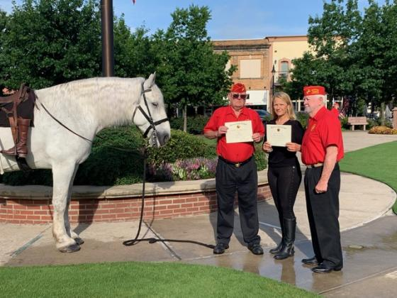 Melissa Beezley Harris was presented with a certificate of merit for her patriotic work that she does Sarge honoring the fallen soldiers and was made an honorary member of the Marine Corps League. Courtesy/Judy Jones via Derb Goodman and Pat Chase