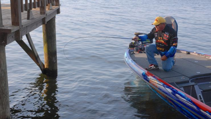 Crappie fishing expert Wally Marshall prepares to shoot a jig beneath a dock on Toledo Bend. Done correctly, Marshall says shooting will catapult the jig at a low angle, parallel to the water, with enough velocity that it will sail far beneath the dock. Courtesy/Matt Williams