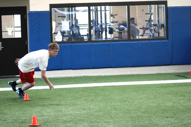 Student athletes run drills this week at The Edge summer conditioning program at Sulphur Springs High School.