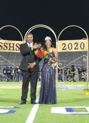 Kerie Wright and her father laugh as she receives her crown