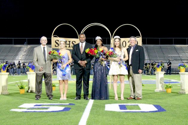 Kerie Wright (center) was crowned the Sulphur Springs Homecoming Queen for 2020 at the homecoming pep rally Thursday night at Gerald Prim Stadium. Joining the queen are runners-up Lexi Colley (left) and Rorie Young (right). Each is accompanied by their fathers.