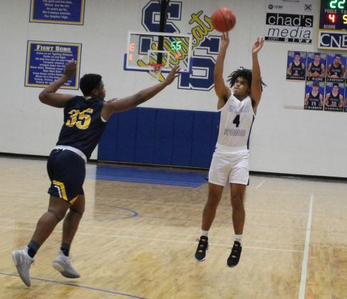 Sulphur Springs senior Boo Wilkerson shoots from long range in Tuesday's district opener win against Pine Tree. Wilkerson had 15 points, including three made 3-pointers. Staff photo by Tyler Lennon