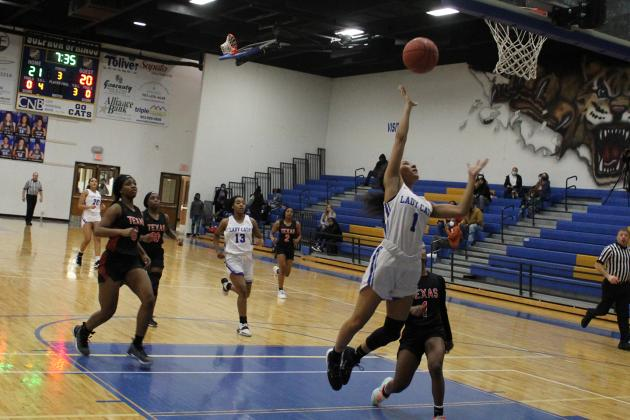 Sulphur Springs' Bre'Asia Ivery goes for a layup in Friday's 52-34 win over Texas High. Ivery had a strong outing, posting 11 points as well as picking up a number of assists. Staff photo by Tyler Lennon