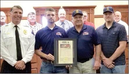 The Hopkins County Commissioners Court recognizes the Cumby VFD for its years of service to the county. The department's history goes back to the 1870s. The current department was founded in 1968. Staff photo by Tammy Vinson