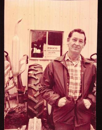 A.W. Steed poses for a photo in front of Steed Tractor and Equipment in Emory in the mid-1980s. Courtesy