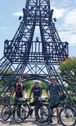 In front of the Paris, Texas Eiffel Tower, (from left) Landon Thornton, Rhett Reid and Eli Sellers pose on their 130-mile bike ride. Courtesy