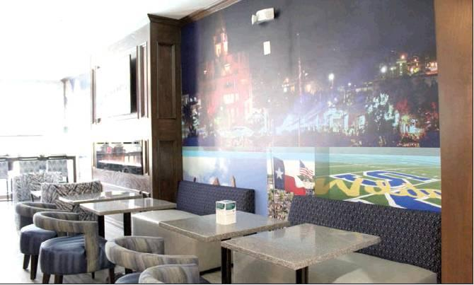 The lobby of the newly-renovated Clarion Pointe hotel displays a mural of scenes from around Sulphur Springs and art from area artists. Anyone interested can see the hotel's accommodations person on Thursday at the hotel's open house. Staff photo by Taylor Nye