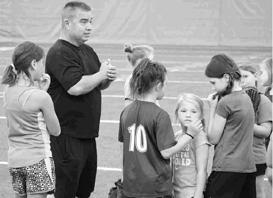 Sulphur Springs softball coach David Carillo gives instruction during the annual Ladycat Softball Camp, held June 10-12. Staff photos by Quinten Boyd