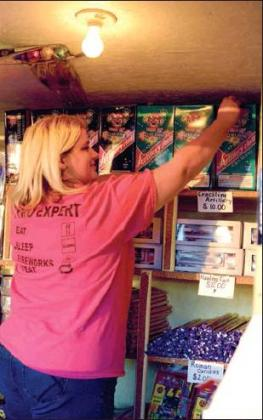 Julie Walker of CCW Fireworks toward Como stocks her stand with popular items such as  artillery shells and Black Cats in preparation for the 2019 New Year celebration.  File photo