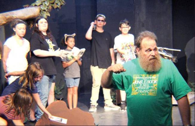 "David Woody (front right) directs ""the horde"" during Community Players auditions for The Neverending Story Wednesday evening. The family-friendly play opens Oct. 18 at Main Street Theatre, 225 Main St. in Sulphur Springs. Staff photo by Jillian Smith"