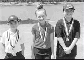 Issac Stanley of Sulphur Springs (right) finished third in the 11 and Under division of the East Texas Junior Golf Tour's recent tournament at Mount Pleasant Country Club. Finishing first was Alex Hammonds of Atlanta (left) and in second was Kylee Strickland of Mount Pleasant (center). Courtesy/Matt Garrett